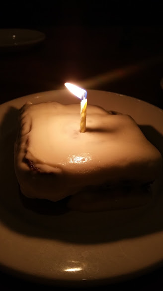 Carrot Cake turned in to birthday cake with a candel