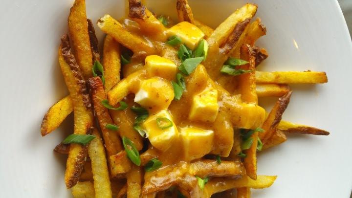 Poutine Hand-Cut Fries, Pork Belly, Tasso Ham, Cheese Curds, Gravy